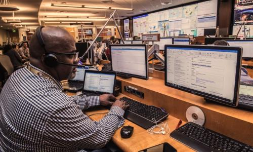 Man monitoring computers at CDC Emergency Operations Center during coronavirus response