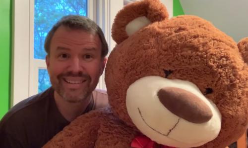 Mark Gaither holding teddy bear