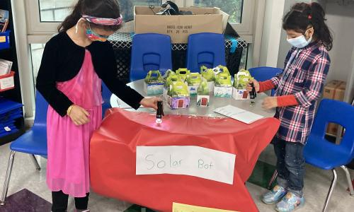 Girls present science project