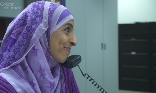 A woman in a hijab talking on the phone.
