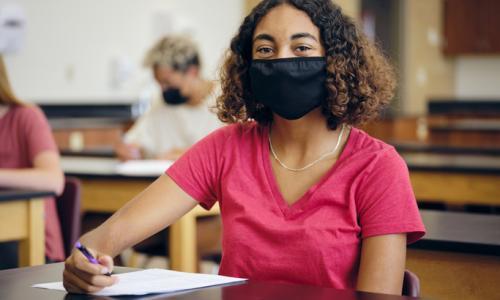 High school student wearing mask