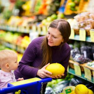Mother and baby looking at fruit