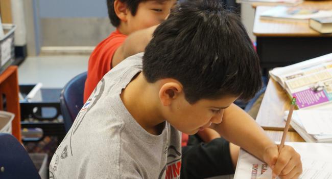a boy writing