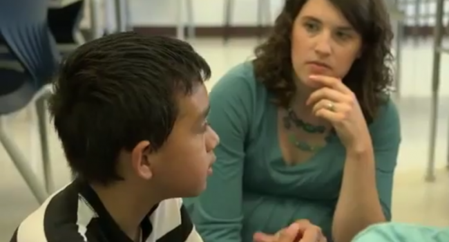 a woman looks at a boy who is talking