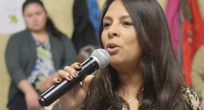 woman speaking in to microphone