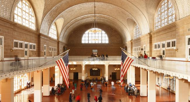the interior of a large builing where there are American flags displayed