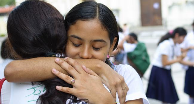 a girl hugging someone