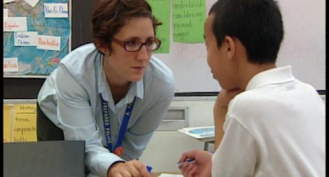 teacher talking to a boy