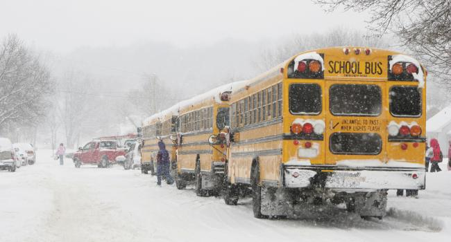 school buses in the snow