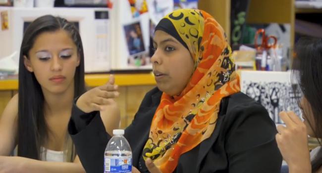 woman in hijab speaking