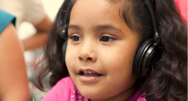 Girl wearing headphones.