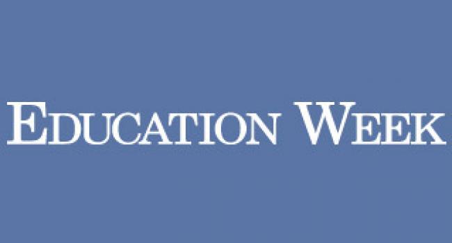 Periwinkle blue Education Week logo.