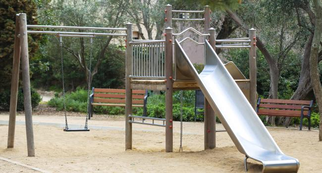 An empty playground with a slide.