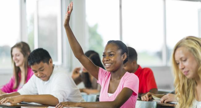 smiling girl raising her hand