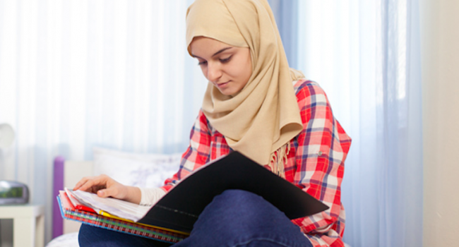 Girl studying in room