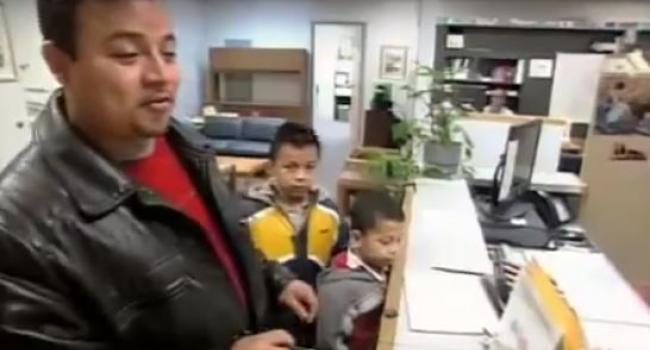 a man with two boys in a school office