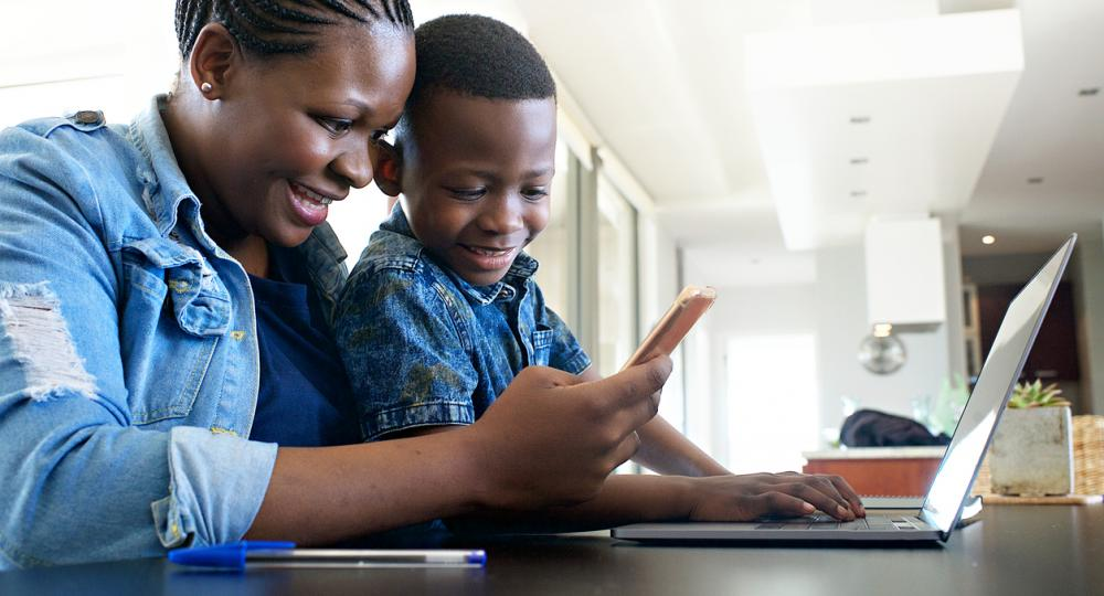 Mother and son looking at laptop